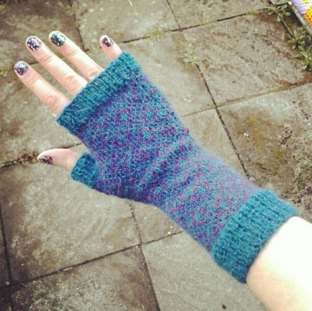 picture of a hand wearing a knitted glove